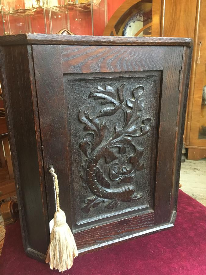 Antique Oak Corner Cupboard With Detailed Carved Door